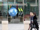 OECD nâng dự báo triển vọng kinh tế với hoạt động thương mại, đầu tư